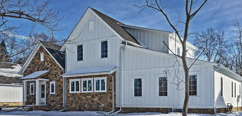 The Buxton front elevation in snow by The Tuckerman Home Group